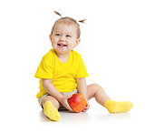 Baby eating apple sitting isolated