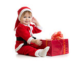 Christmas baby with box in Santa's clothes isolated