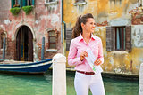 Happy young woman with map in venice, italy