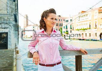 Portrait of young woman on grand canal in venice, italy