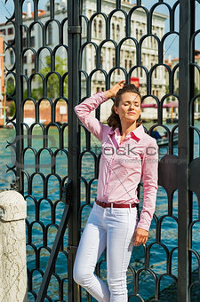 Portrait of relaxed young woman on grand canal in venice, italy