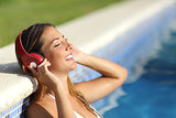 Relaxed woman listening to the music with headphones