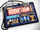 Addiction on the Display of Medical Tablet.