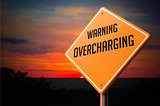 Overcharging on Warning Road Sign.
