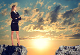 Businesswoman standing on the edge of rock gap