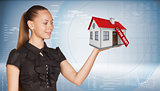 Businesswoman holding model house with tag for rent