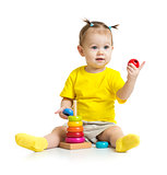 happy baby playing with colorful wood pyramid or tower isolated