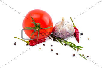 Tomato, garlic, chili peppers and rosemary isolated on white background.