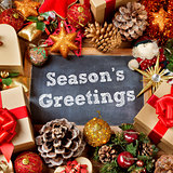 text seasons greetings and gifts and christmas ornaments
