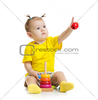 baby playing with colorful toy and pointing by finger isolated