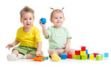Adorable children playing colorful toys isolated