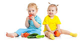 Kids eating fruits and vegetables isolated