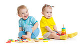 Adorable kids playing educational toys isolated