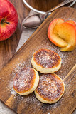 Cheese pancakes with baked apples