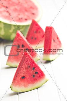 sliced watermelon on kitchen table