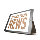 Tablet with education news word