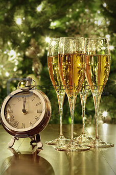 Champagne glasses, clock with lights