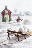 Wooden sled and snowballs with wintery background