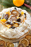 Pavlova with spicy cream with Christmas decor.