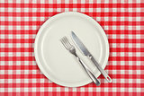 Empty plate on restaurant table