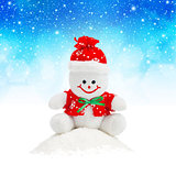 Smiling Generic Christmas Snowman Toy sitting on snow pile
