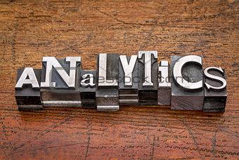 analytics word in metal type