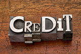 credit word in metal type