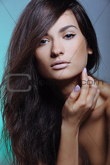 beautiful girl with perfect fresh skin and natural visage touching her face