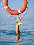 Lifebuoy for drowning man in sea or ocean water. Insurance concept.