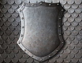 old medieval coat of arms shield over scales armour background