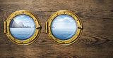 Two ship windows with tropical sea or ocean island. Travel and adventure concept.