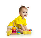 baby playing with colorful tower isolated