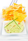 Nachos with guacamole dip.