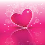 Heart shape with its reflection on colorful background to the Valentine's day.