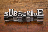 subscribe word  in metal type