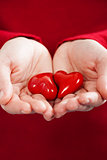 Red hearts  in hands - St. Valentine concept