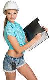 Beautiful girl builder writes with ballpoint pen in office folder