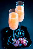Two bellini cocktails with bunch of grapes
