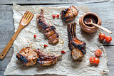 Grilled pork ribs on the wooden background