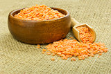red lentils in wooden bowl