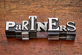 partners word in metal type
