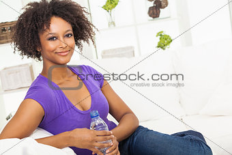 African American Woman Drinking Bottle of Water