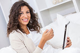 Woman Drinking Tea or Coffee Using Tablet Computer