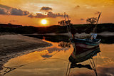 colorful tropical sunset with boat