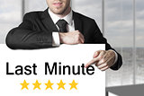 businessman pointing on sign last minute