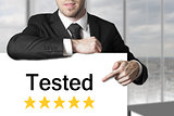 businessman pointing on sign tested