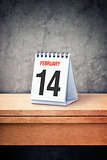 Valentine day concept. February 14th on desk calendar at office