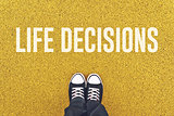 Young man standing at Life Decisions sign
