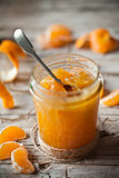 tangerine jam in a glass jar