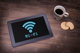Tablet with Wi-Fi connection on a wooden desk